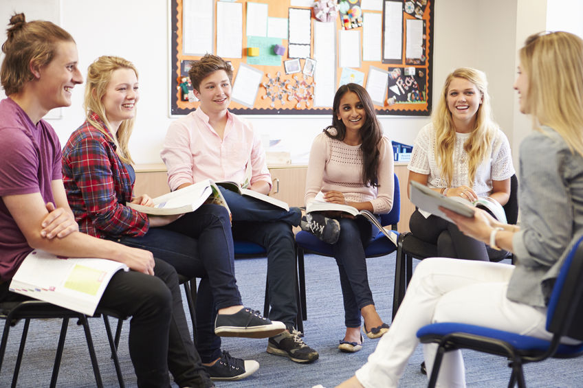 42314651 - college students with tutor having discussion